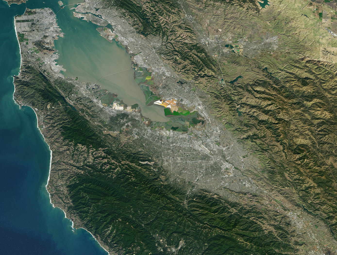 Landsat 7 image of the Santa Clara area acquired Nov 16, 2015. Landsat 7 is a U.S. satellite used to acquire remotely sensed images of the Earth's land surface and surrounding coastal regions. It is maintained by the Landsat 7 Project Science Office at the NASA Goddard Space Flight Center in Greenbelt, MD...Landsat satellites have been acquiring images of the Earths land surface since 1972. Currently there are more than 2 million Landsat images in the National Satellite Land Remote Sensing Data Archive.