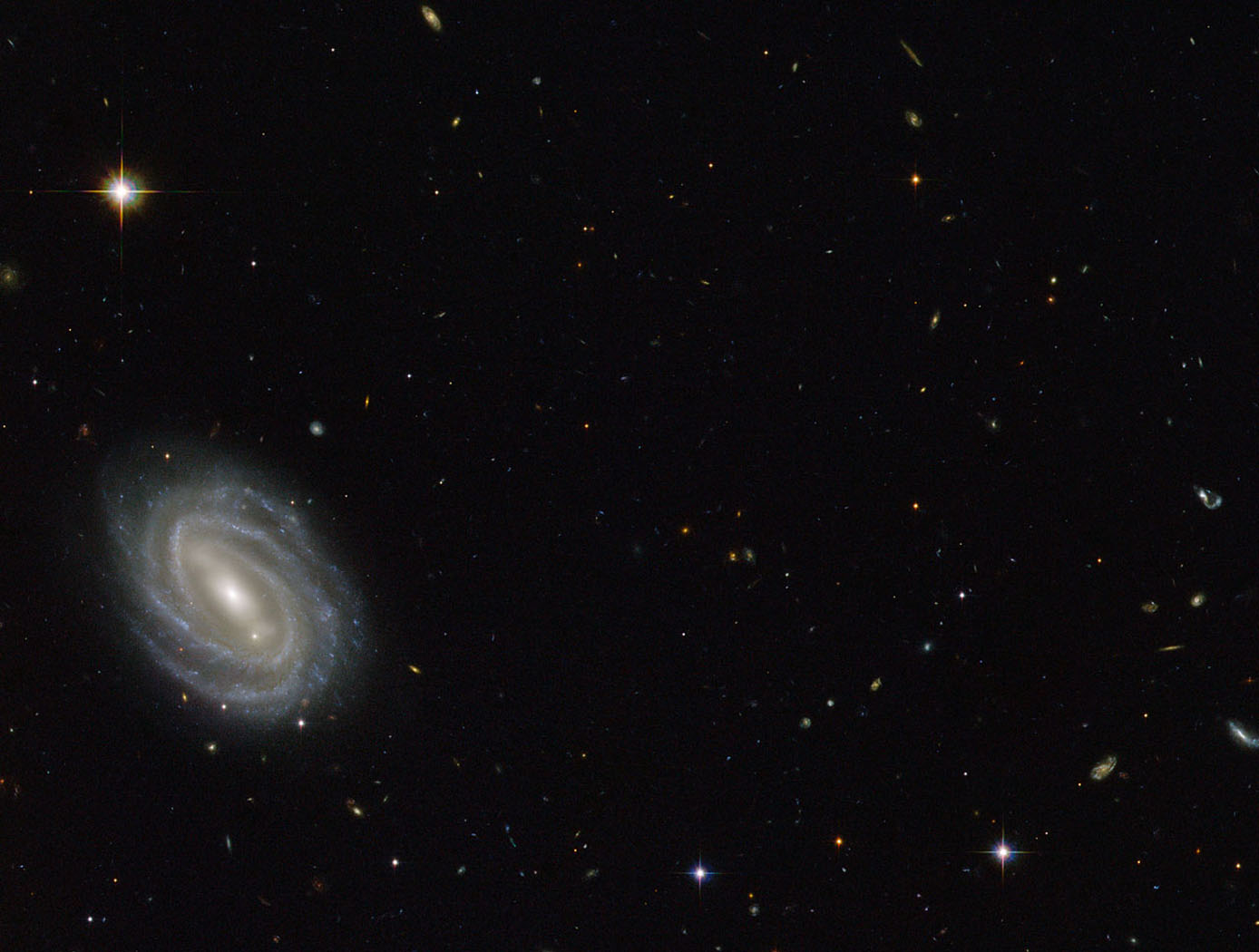 Hubble Sees Spiral in Serpens; Credit: ESA/Hubble & NASA,