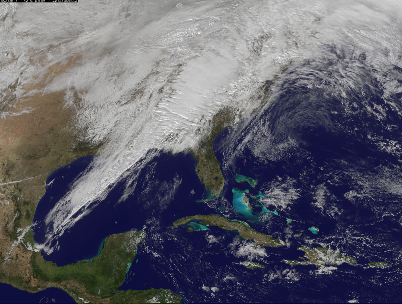 A powerful cold front moving from the central United States to the East Coast.